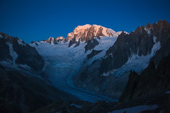 Morning light (Ulrik Hasemann) Tags: morning blue light orange sunlight mountain france mountains alps color canon august glacier climbing alpine dslr chamonix mtblanc 2012 alpinism 5dii