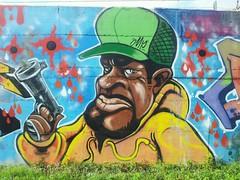 Graffito, stazione Pregnana Milanese (Leonaso) Tags: streetart colore spray graffito stazione rapper pistola cappello soldi pregnana flickrandroidapp:filter=none