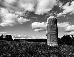 the silo approach (Jonathan Dacey) Tags: sky blackandwhite bw ontario canada field clouds rural blackwhite nikon farm country silo top20blackandwhite d7000 tokina1116mmf28dxpro