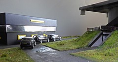 Intelligence Meeting at Fylefield Base. (ManOfYorkshire) Tags: fylefield secret operations base gerry anderson inspired 176 scale model oogauge diorama homemade scratchbuilt oxford diecast rangerover black intelligence meeting building landingpad