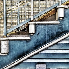 Never look backwards or you'll fall down the stairs  #photography #photooftheday #photo #streetphotography #london #londonunderground #tubestation #architecture #abstractarchitecture #lines #abstract #abstraction #stairs #blue #highbarnet (Andrea Kennard) Tags: instagramapp square squareformat iphoneography uploaded:by=instagram