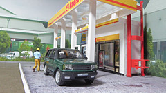 Filling Up The Range Rover. (ManOfYorkshire) Tags: 176 scale model car rangerover shell garage filling station petrol diesel p38 cararama diecast diorama oogauge homemade green figure fillingup fuel landrover