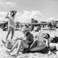 Sunny days, sweeping the clouds away (mkc609) Tags: street streetphotography bw blackandwhite blackwhite urban candid nyc newyork newyorkcity brooklyn coneyisland beach unicorn sunbathers