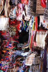 Mercado Central de San Pedro - Cusco (Michael McMillen) Tags: peru southamerica south america cusco cuzco mercado central sanpedro san pedro market stall alpaca llama material colour pattern seller bargain carpet cloth