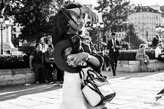 Street - The beautiful selfie (Franois Escriva) Tags: street streetphotography candid people olympus omd black white bw noir blanc nb selfie woman beautiful pretty cute sky blue light sun bag hat phones asian buildings trees paris france photo rue