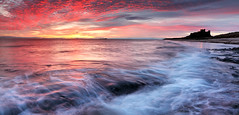 Bamburgh Sunrise (rgarrigus) Tags: ocean morning england seascape castle water sunrise landscape coast surf waves shoreline dramatic medieval northumberland coastal shore coastline drama bamburgh greatphotographers garrigus robertgarrigus robertgarrigusphotography