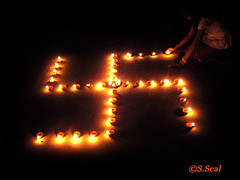 swastik (shanzz ) Tags: carnival light black colour macro lamp girl beautiful beauty festival night dark photography dawn photo colorful joy celebration flame 100 diwali 50 utsav deepawali bengali diya deewali swastik depawali