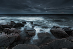 Dim R&W (- David Olsson -) Tags: blue sea lake seascape cold nature water clouds dark landscape lowlight nikon rocks waves gloomy darkness cloudy sweden stones tripod vivid sigma windy september boulders filter bluehour dim 1020mm grad winds 1020 murky dusky hitech vänern 2012 lively dx hammarö värmland aftersunset lakescape gnd earlyautumn pastsunset d5000 takene scenicsnotjustlandscapes davidolsson hammarösydspets 09hard almostovercast