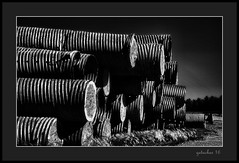 Plays with Pipe (the Gallopping Geezer 3.8 million + views....) Tags: shadow mi rural canon construction michigan pipe stack pile round bunch thumb smalltown stacked geezer 24105 2016 5d3 coragatedpipe