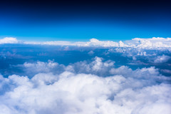 Clouds with blue sky high above the ground (ZlataMarka) Tags: above airplane blue high nature sky view white transportation travel air atmosphere flying horizon journey plane midair aviation background clouds distant flight peak under color relief photography earth image topography natural weather