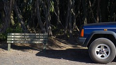 A Long Way From The Carpark (milo J) Tags: nature hiking walking wilson promontory australia victoria bush country national park sony a6000 digital colour blue sign signpost way mark lighthouse funny car four wheel drive trees
