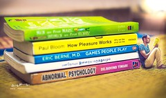 Books world! Miniature  (SheikPhotography) Tags: miniature tiltshift tilt shift tiny guy people photoshop manipulation picture edit editing chennai mincro macro big world books little micro reading love fun india geek nerdy lost thought study college examination exams exam tamilnadu nikon d3200 35mm prime lens photoshopped