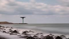 Maasmond Zuiderdam (BraCom (Bram)) Tags: longexposure light sea lighthouse holland canon rotterdam rocks widescreen nederland thenetherlands noordzee zee le northsea 169 vuurtoren maasvlakte zuidholland rotsen zuiderdam breedbeeld langesluitertijd canonef24105mm nd110 maasmond 110nd bracom maasvlakterotterdam bw110endgrey canoneos5dmkiii