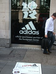 Invoice in front of the Adidas store (War on Want) Tags: olympics adidas sweatshops workersrights