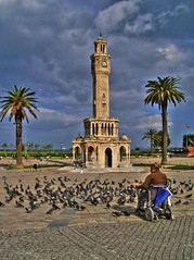 Man and birds (Metin Canbalaban) Tags: voyage trip travel vacation cloud holiday tower clock turkey trkiye clocktower konak hdr izmir bulut metin tatil turkei seyahat turkie trkie saatkulesi metincanbalaban canbalaban