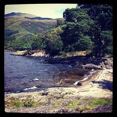 Loch Lomond (Anne Oldfield) Tags: trees sky mountains rock square landscape scotland squareformat lochlomond iphoneography instagramapp xproii uploaded:by=instagram