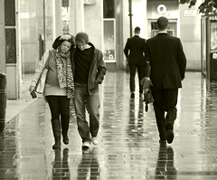 walkin' in the rain with the one i love (Broady - Salford art and photography) Tags: street city urban woman man manchester streetphotography lovers broady memorycorner memorycornerportraits stephenbroadhurst olympusmcr