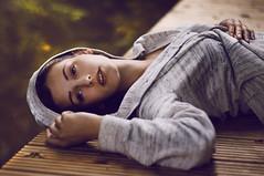 home is peace (laura zalenga) Tags: wood woman green nature water girl face yellow river hoodie hand bokeh sleep laying laurazalenga