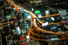 Highest Aerial view of Bangkok Highway Cityscape (Patrick Foto ;)) Tags: city sky urban building bus cars night truck wagon landscape thailand lights evening twilight highway asia downtown cityscape view traffic motorway time dusk bangkok centre capital transport trails headlights busy rush hour lane freeway vehicle metropolis intersection rushhour interstate expressway roads van congestion interchange converge baiyok