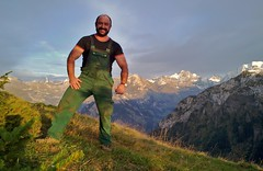 rugged mountains, rugged farmhand (Marsum) Tags: rural buff sturdy rugged brawny landleben muscled swissmountains abendstimmung stocky swissfarmer johndeerelatzhose beardedfarmer