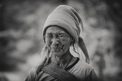 hani woman~ Yunnan (~mimo~) Tags: china portrait woman smile fierce bokeh headscarf yunnan ethnic load minority wrinkles hani Potd:country=menaen