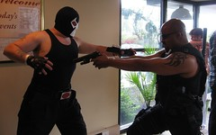 Bane Battles Blade while Zombie Eats Itself (MorpheusBlade) Tags: tattoo costume cosplay muscle zombie bald superhero bane comicon tactical daywalker bladetheseries bladehouseofchthon bladethevampireslayer thedarkknightrises bladethevampirekiller bladethevampirehunter 2012hersheycomiccon 2012hersheycomicon hersheycomiccon hersheycomicon
