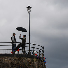 Cloudy in the east (ho_hokus) Tags: uk england cloud rain umbrella coast seaside cloudy unitedkingdom britain norfolk september raining 2012 cromer nikond80 tamron18270mmlens