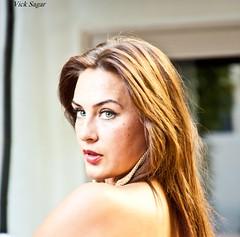 kz (MadVick) Tags: portrait canon eyes head earrings brunette russian 50d