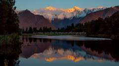 """not quite perfect but still beautiful"" (rina sjardin-thompson photography) Tags: landscape light lake lakematheson rinasjardinthompson rural reflection mountains mtcook mttasman southisland southwestland southernalps sunset still newzealand nz nature westcoast water waterscape fox glacier foxglacier"