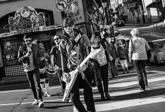 Walking guitar player (feldmanrick) Tags: streetphotography street sanfrancisco guitar candid unposed outdoor decisivemoment music monochrome bw blackandwhite