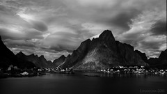 it's a life on the edge (lunaryuna) Tags: norway lofoten lofotenislands lofotenarchipelago moskenesisland lofotenwall reine town sky clouds cloudscape lightmood rideofthevalkyries norsemythology northerndreamworlds lunaryuna blackwhite bw monochrome