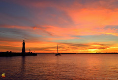 Lighthouse, Moondance Cat, and Fire in the Sky (DTD_5185) (masinka) Tags: outdoors lake erie lakeshore shoreline colors clouds wild bold vivid show catamaran lighthouse light buffalo main silhouette river ny newyork city waterfront red orange yellow spectacular scenic view
