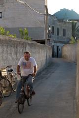 American Dream (Antonio Martorella) Tags: antomarto ntomarto italia italy sicilia sicily favignana isola island street strada city citylife persona people uomo man americandream usa bandiera flag usaflag bicicletta bicycle santacaterina