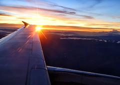 early flight (sussexscorpio) Tags: aeroplane flight clouds sun sunri colours wing space sky lima