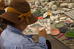 Painting pottery (NettyA) Tags: travel woman canon painting asia vietnamese factory plate vietnam pottery southeast eos550d
