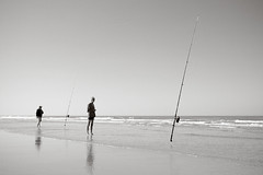 Beach Fishing (Harry Wedzinga) Tags: sea blackandwhite bw white black beach water netherlands canon landscape fishing nederland northsea beachfishing friesland schiermonnikoog fryslan harrywedzinga
