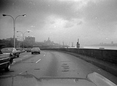 Cruising down the dilapidated 1970s Henry Hudson Parkway on the west side toward midtown Manhattan in my dads 1965 Pontiac Bonneville. Lots of 1960s and 1970s cars zoom along in the faster lanes.  Aug. 1975 (wavz13) Tags: blackandwhite zoom 110 1975 pontiac oldphotographs westsidehighway 1970s oldphotos oldcars dilapidated oldnewyork vintagecars 1965 vintagephotos pocketcamera oldphotography vintagephotographs submini 110film lostnewyork vintagephotography vintagenewyork 1960scars 1970sphotos pocketinstamatic 1970scars oldhighways 1970sphotographs vintagemanhattan 1970sphotography oldwestsidehighway 1970snewyork 1970smanhattan 1970swestsidehighway 1970swestside 1970shighway vintagehighways 1970sconstruction 1970shudsonriver 1970shenryhudsonparkway oldhenryhudsonparkway vintageupperwestside oldupperwestside 1970supperwestside 1970shighways