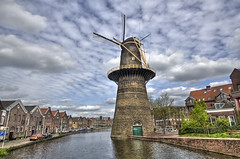 Windmill (Jan Kranendonk) Tags: street city blue trees houses sky holland reflection mill water netherlands windmill dutch stone clouds buildings town canal big europe quiet cloudy scenic large nobody quay warehouse molen schiedam windmolen
