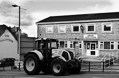 Parking fine protest ! (Neil. Moralee) Tags: street b white tractor black clamp parking w wheels fine protest devon clamping honiton claas neilmoralee