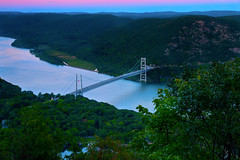Sunset over Bear Mountain Bridge (SunnyDazzled) Tags: bear longexposure bridge pink blue trees sunset sky mountain newyork mountains reflection green history water river landscape evening scenery hills valley hudson orangecounty distance westchester anthonysnose