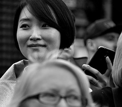 Look Away (Owen J Fitzpatrick) Tags: ojf people photography nikon fitzpatrick owen j joe street pavement chasing d3100 ireland editorial use only ojfitzpatrick eire dublin republic city face pride parade woman girl pretty beauty beautiful crowd serene tamron visage hair asiatic asian oriental candid natural eastern orient smile smiling brunette device phone bw black white mono monochrome candidphotography candidphoto unposed blackwhite blackandwhite asiatica ring attractive eyes looking look away blancoynegro pretoebranco