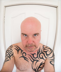 Tattooed selfee. (CWhatPhotos) Tags: tattoo tattooed tattoos inked tribal chest shoulders selfee me photographs fish eyed selfie have it photograph pics pictures pic picture image images foto fotos photography artistic that which contain digital cwhatphotos dark portrait body upper torso tatt ink pose face look beard samyang olympus em10 mk ii 65mm fisheye prime lens warrior curved curves bodyart