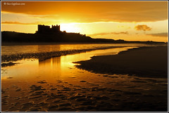 Golden Moments! (dave091260) Tags: sunset castle beach canon reflections dawn colours northumberland bamburgh bamburghcastle canoneos500d canonrebelt1i bamburghday1 dave091260 davecappleman davecapplemanphotography