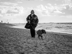 the lady with the dog // sylt, germany (pamela ross) Tags: ocean street dog sun beach weather pen germany walking wind sylt ep1 olymous
