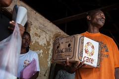 4 (CARE Deutschland Luxemburg) Tags: poverty africa baby cooking water rain soap village rice wash sierraleone care cholera illness watsan limba kolisokoh