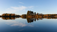 Glassy lake by Vrigstad in Sweden (mistermacrophotos) Tags: morning autumn lake water canon still sweden foliage mk2 5d glassy vrigstad