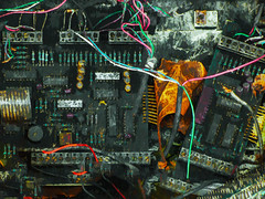 Burnt Out (Steve Taylor (Photography)) Tags: black pink yellow orange red purple closeup newzealand nz southisland canterbury christchurch cbd city leaf burnt circuitboard components wiring resistor terminal
