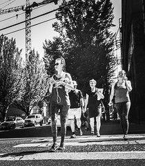 The Heat Of The Sun (TMimages PDX) Tags: iphoneography photography image photo photograph streetscene fineartphotography geotagged people urban city street streetphotography portland pacificnorthwest sidewalk pedestrians buildings avenue road blackandwhite monochrome vignette