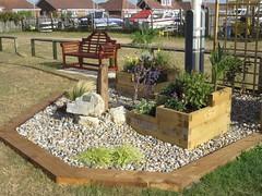3581 Mini garden celebrating 50 years of the Inshore Lifeboat (Andy panomaniacanonymous) Tags: 20160820 bbb bench garden ggg kent littlestoneonsea memorial mmm rnli romneysands seat sss