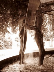 Trauttsmansdorff Castle Gardens, Merano (Ren193) Tags: water sculpture sepia man woman love romance passion botanics italy merano shadow sunlight light dark contrast fluidity discover sun leaves waterfall fountain summer
